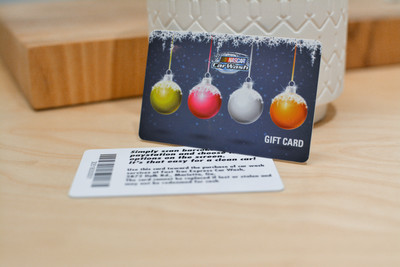 Two cards showing the front and back of a plastic gift card with a winter holiday design