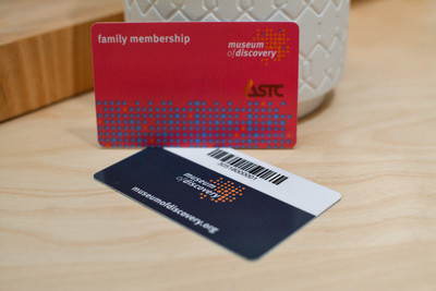 Two plastic giftcards showing barcode encryption on the backside