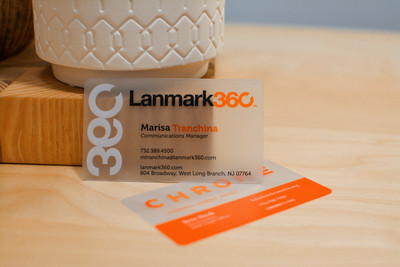 Two different plastic business card designs showing how bright orange prints on the plastic material
