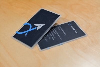 A closer look at the front and backside of a business card design featuring a paper airplane