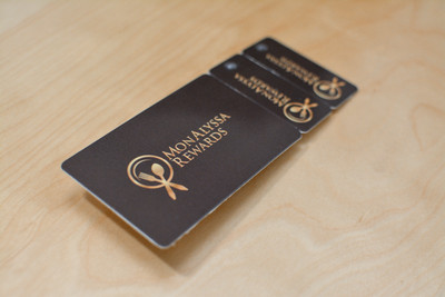 Two key tags and one plastic card attached together with a simple solid black background and logo design