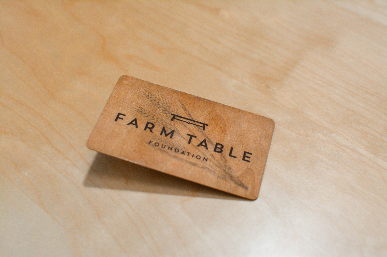 A simple wooden design with a company logo on the front