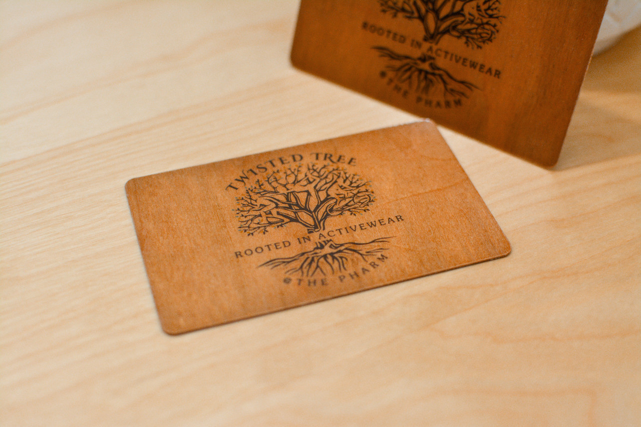 Both sides of a colorful wooden card designs for a yoga studio