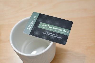 A shiny dental gift card with a patterned background