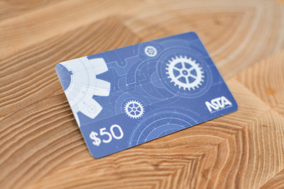 A blue card design with gears and blueprint graphics