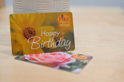 Two plant shop giftcards featuring photos of flowers and a happy birthday message