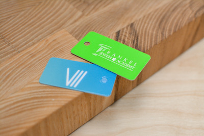 A green key tag design and a blue key tag design