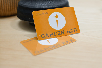Orange cards with a carrot logo for a salad restaurant