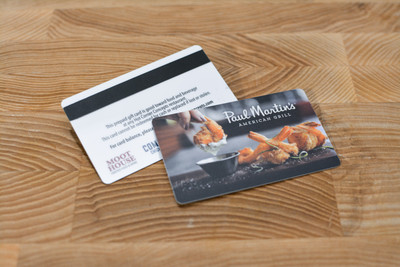 Card designs for a seafood company using a photograph of a shrimp entree