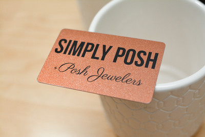 A very sparkly copper-colored card for a jewelry store