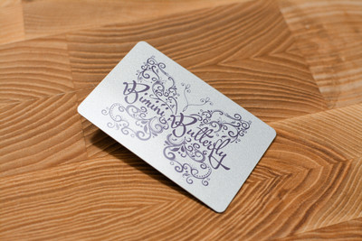 A hand-drawn card design with a reflective silver background