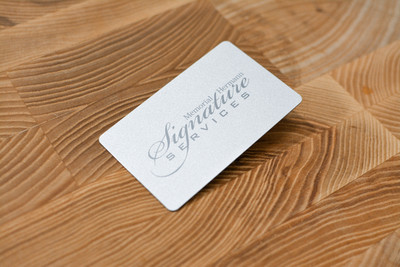 A subtle metallic card design with a simple script logo