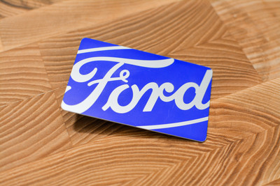 A very bright card design with a chrome finish and the Ford logo