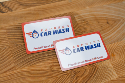 Two plastic cards for a car wash with retro designs