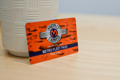 An orange card design with water drops and a vintage car logo