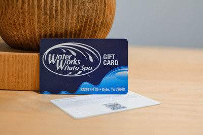 A blue card used by a car wash with a QR code on the backside